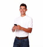 Smiling young man with a cellphone. Royalty Free Stock Image