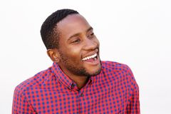 Smiling young man with checkered shirt Stock Photos