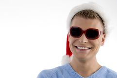 Smiling young man with christmas hat Royalty Free Stock Images