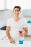 Smiling young man cleaning kitchen counter Royalty Free Stock Photo
