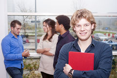 Smiling young man on a college campus Stock Images