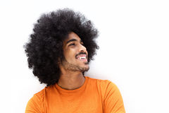 Smiling young man with cool hair looking away Stock Images