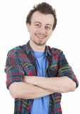 Smiling young man with crossed arms Royalty Free Stock Image