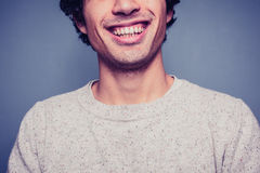 Smiling young man with dirty teeth Royalty Free Stock Image