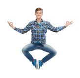 Smiling young man flying in air Royalty Free Stock Image