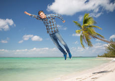 Smiling young man flying in air Stock Images