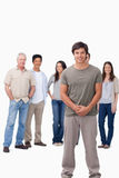 Smiling young man with friends behind him Stock Photo