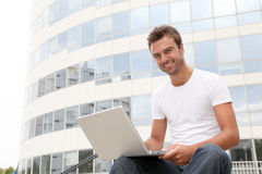 Smiling young man in front of building Stock Photography