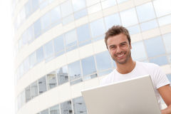 Smiling young man in front of building Royalty Free Stock Photo