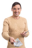 Smiling young man giving dollar bills Stock Photography