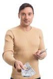 Smiling young man giving dollar bills Stock Photos