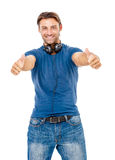 Smiling young man giving you the thumbs up Royalty Free Stock Photo