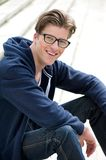 Smiling young man with glasses Royalty Free Stock Images