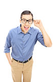 Smiling young man with glasses looking at camera Royalty Free Stock Images