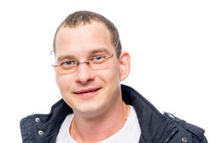 Smiling young man with glasses portrait stock photo