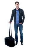 Smiling young man going to travel Stock Photos