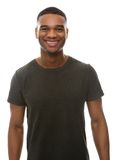 Smiling young man with green t-shirt Stock Photos