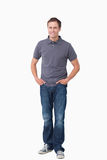 Smiling young man with hands in his pockets Stock Photo
