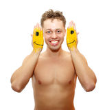 Smiling young man with hands painted with yellow Royalty Free Stock Images