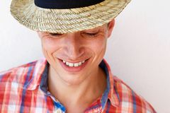 Smiling young man with hat against white background Stock Photography