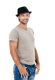 Smiling young man with a hat. A smiling young man posing against a white background Royalty Free Stock Image