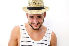 Smiling young man with hat posing against white background Stock Photos