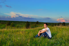 Smiling young man on the hills Stock Photography
