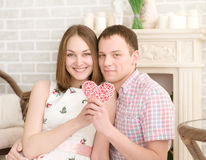 Smiling young man and his pretty girlfriend Royalty Free Stock Image