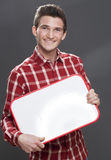 Smiling young man holding a blank board as job teaser Stock Image