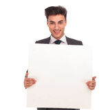 Smiling young man holding a blank board Royalty Free Stock Image