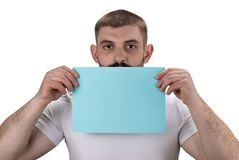 Smiling young man holding blank sign in hands isolated on white royalty free stock photo