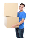 Smiling young man holding cardboard box Royalty Free Stock Images