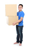 Smiling young man holding cardboard box Royalty Free Stock Photo