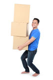 Smiling young man holding cardboard box Stock Image