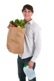 Smiling Young Man Holding Groceries Stock Photo