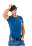 Smiling young man holding a  hat Stock Images