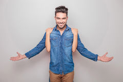 Smiling young man holding his hands open Royalty Free Stock Image