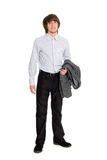 Smiling young man holding a jacket Royalty Free Stock Image