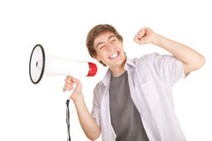 Smiling young man holding megaphone Royalty Free Stock Photos