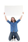 Smiling young man holding a placard Royalty Free Stock Images