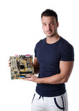 Smiling young man holding and showing computer motherboard Stock Photography