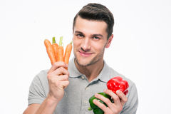 Smiling young man holding vegetables Royalty Free Stock Images