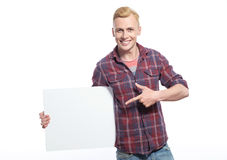 Smiling young man holding white sheet of paper Stock Photo