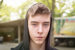 Smiling young man with hoodie Stock Images