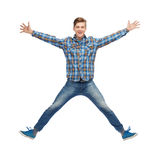 Smiling young man jumping in air Royalty Free Stock Photography