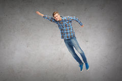 Smiling young man jumping in air Stock Photo