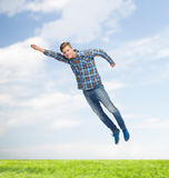 Smiling young man jumping in air Royalty Free Stock Photo