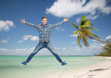 Smiling young man jumping in air Royalty Free Stock Images