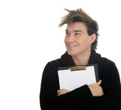 Smiling young man keeping blank clipboard Royalty Free Stock Photos