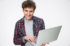 Smiling young man with laptop Stock Photography